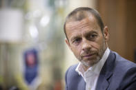 UEFA President Aleksander Ceferin during an interview with The Associated Press in Lisbon, Portugal, Sunday, Aug. 23, 2020. Ceferin says he will hold talks about retaining the single-game eliminator format that has been used to complete the pandemic-disrupted Champions League and Europa League seasons. (AP Photo/Manu Fernandez)