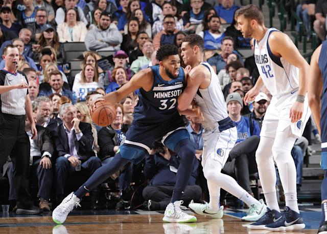 DALLAS, TX - APRIL 3: Karl-Anthony Towns #32 of the Minnesota Timberwolves jocks for a position during the game against Dwight Powell #7 of the Dallas Mavericks on April 3, 2019 at the American Airlines Center in Dallas, Texas. (Photo by Glenn James/NBAE via Getty Images)