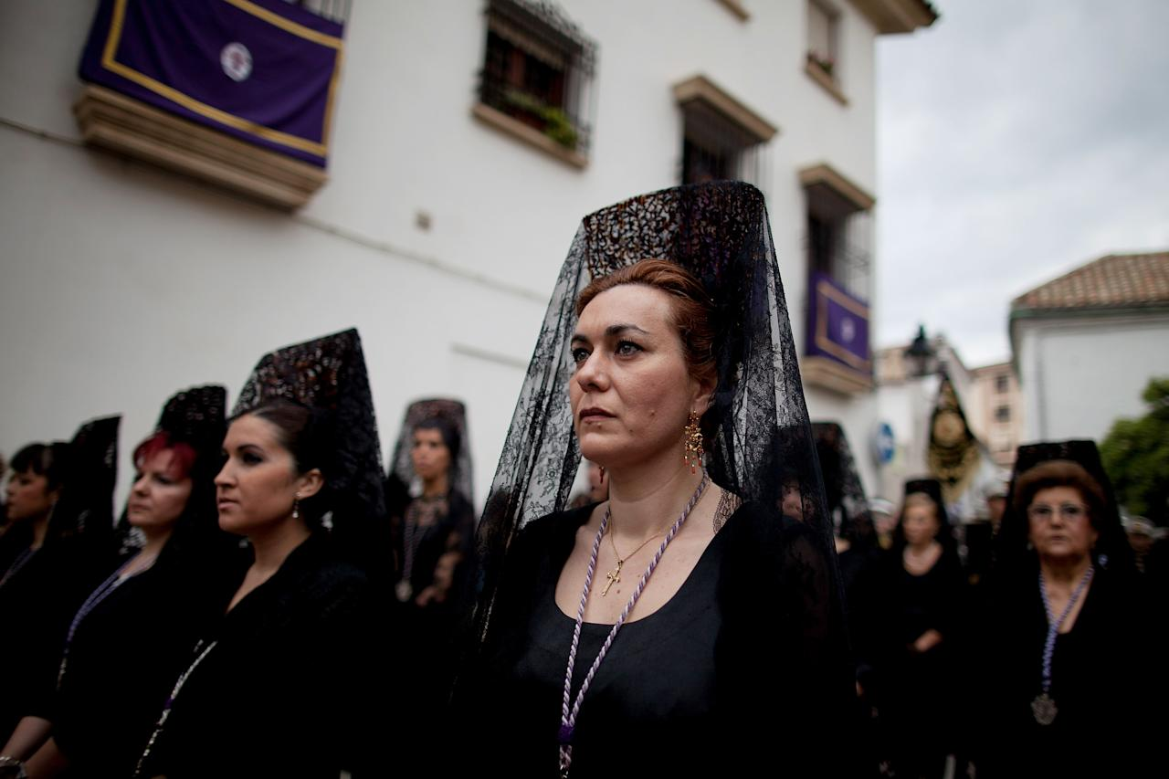 CORDOBA, SPAIN - APRIL 04:  Women wearing a 'mantilla' take part in the 'Pasion' brotherhood walk during a Holy Week procession on April 04, 2012 in Cordoba, Spain. Many towns in Spain celebrate Easter week with processions. (Photo by Pablo Blazquez Dominguez/Getty Images)