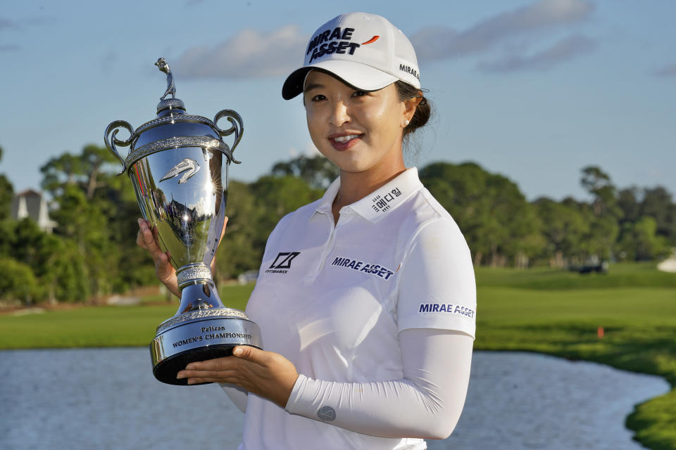 Sei Young Kim, of South Korea, holds the trophy after winning the LPGA Pelican Women's Championship golf tournament Sunday, Nov. 22, 2020, in Belleair, Fla. (AP Photo/Chris O'Meara)