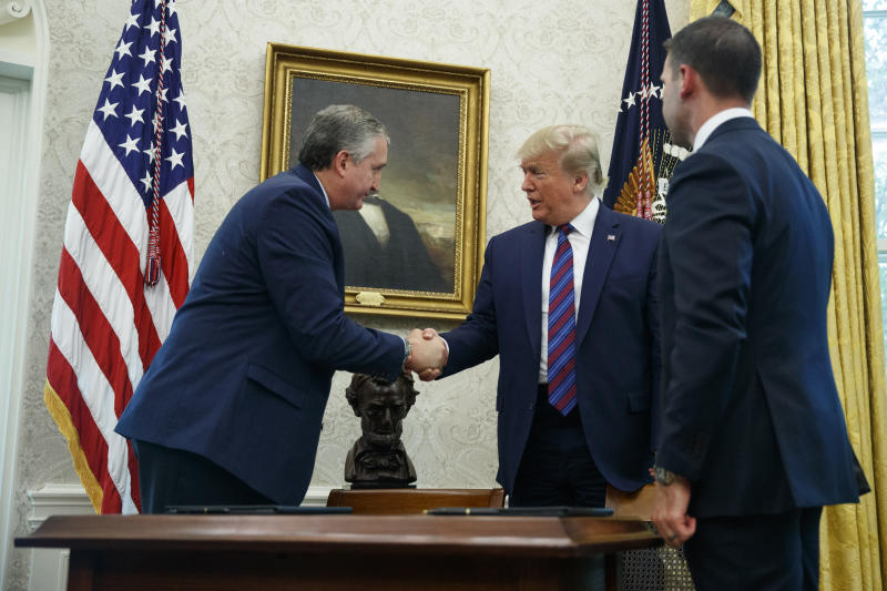 President Donald Trump, joined by acting Department of Homeland Security Secretary Kevin McAleenan, right, shakes hands with Guatemalan Interior Minister Enrique Degenhart in the Oval Office of the White House in Washington, Friday, July 26, 2019. Trump announced that Guatemala is signing an agreement to restrict asylum applications to the U.S. from Central America. (AP Photo/Carolyn Kaster)