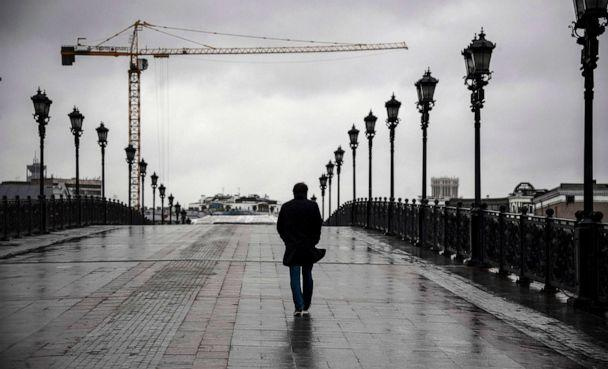 PHOTO: A man walks along a bridge in central Moscow, Russia, on June 2, 2020. (Alexander Nemenov/AFP via Getty Images)