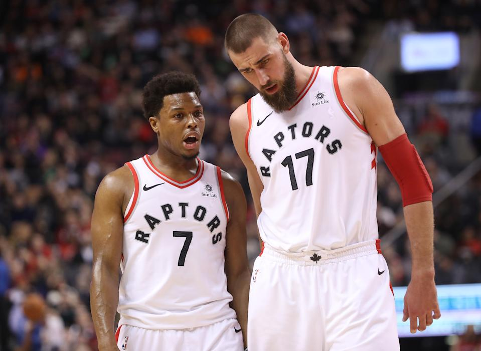 TORONTO, ON - JANUARY 17: Kyle Lowry #7 of the Toronto Raptors talks to Jonas Valanciunas #17 against the Detroit Pistons at Air Canada Centre on January 17, 2018 in Toronto, Canada. NOTE TO USER: User expressly acknowledges and agrees that, by downloading and or using this photograph, User is consenting to the terms and conditions of the Getty Images License Agreement. (Photo by Tom Szczerbowski/Getty Images)