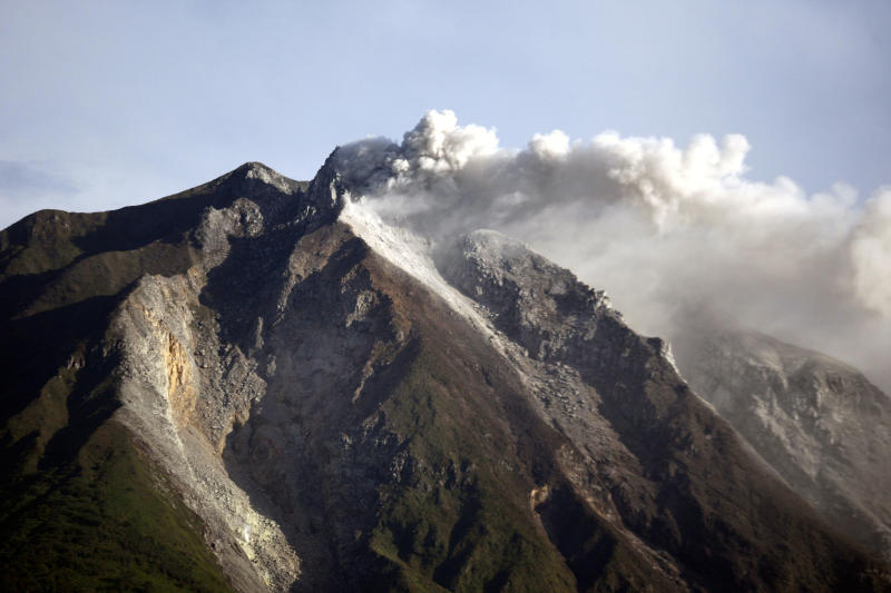 Mount Sinabung spews volcanic materials from its crater as seen from Karo, North Sumatra, Indonesia, Monday, Sept. 16, 2013. Thousands of people have been evacuated from their homes after the volcano erupted Sunday. (AP Photo/Binsar Bakkara)