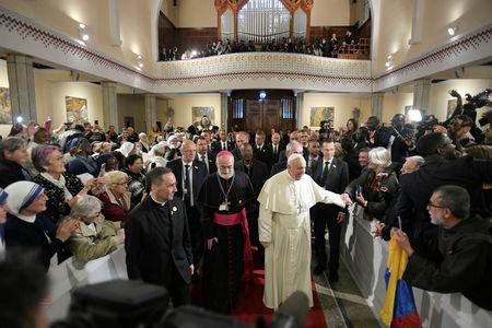 Pope Francis is seen during a meeting with representatives of other Christian denominations at Saint Peter's Cathedral in Rabat, Morocco, March 31, 2019. Vatican Media/Handout via REUTERS