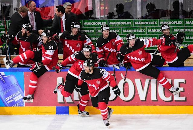 Players of team Canada celebrate after winning the gold medal match Canada vs Russia at the 2015 IIHF Ice Hockey World Championships on May 17, 2015 at the O2 Arena in Prague (AFP Photo/Jonathan Nackstrand)