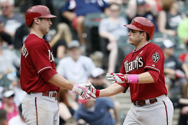 After hitting a two-run home run, Arizona Diamondbacks' Miguel Montero, right, celebrates with teammate Paul Goldschmidt, who also scored, during the ninth inning of a baseball game against the Chicago White Sox, Sunday, May 11, 2014, in Chicago. (AP Photo/Andrew A. Nelles)