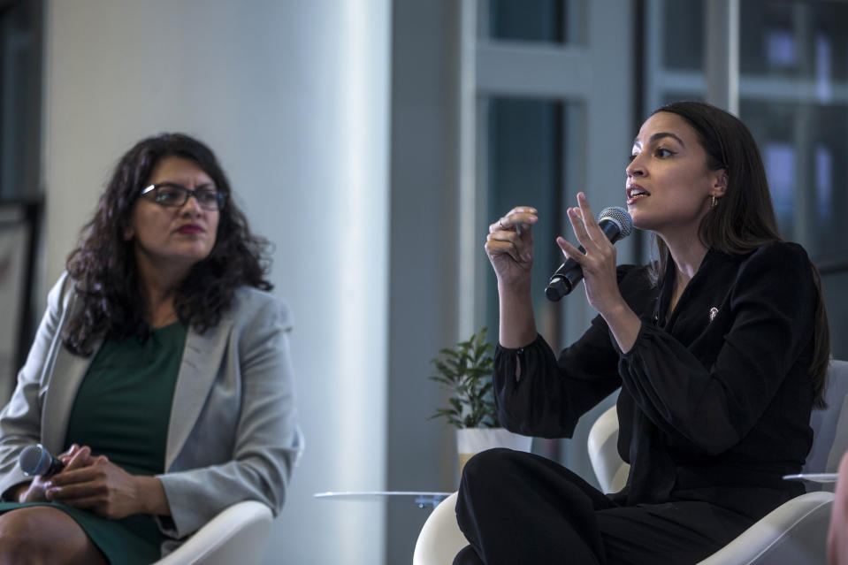 Reps. Rashida Tlaib and Alexandria Ocasio-Cortez at a town hall hosted by the NAACP in 2019. (Zach Gibson/Getty Images)