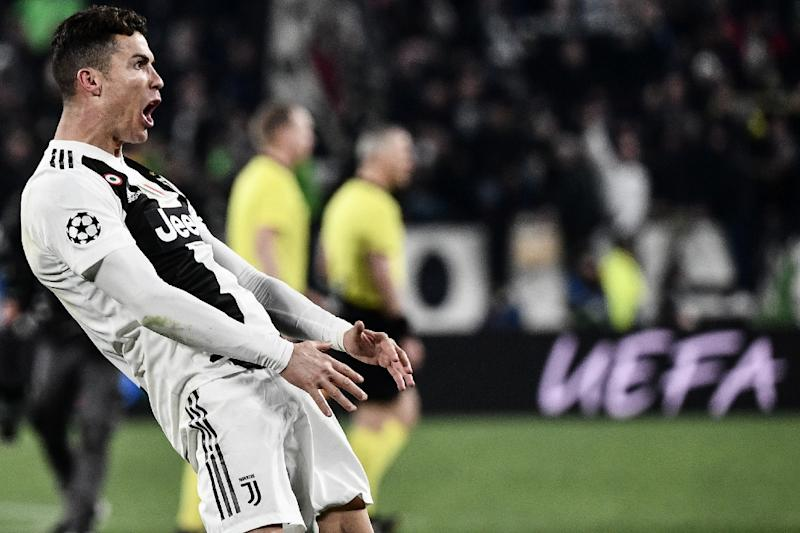 Juventus  39  Portuguese forward Cristiano Ronaldo celebrates after scoring  a hat-trick against 28a54afd26d