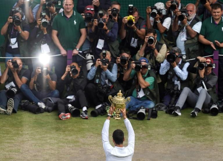 Centre of attention: Novak Djokovic holds the winner's trophy after beating Roger Federer in the 2019 Wimbledon final