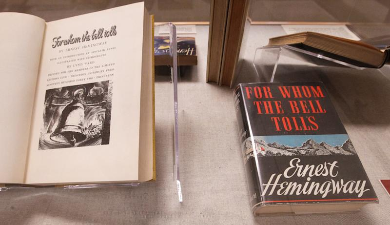 """At left is a 1942 edition of """"For Whom the Bell Tolls"""" with an introduction by Sinclair Lewis and on the right is a 1940 copy on display at the University of South Carolina in Columbia, S.C. Tuesday Sept. 25, 2012. The University of South Carolina Libraries is now home to the most complete collection of Ernest Hemingway's published work, thanks to a newly acquired collection of more than 1,200 items of the 20th century American writer. (AP Photo/The State,Tim Dominick ) ALL LOCAL MEDIA OUT, (TV, ONLINE, PRINT)"""