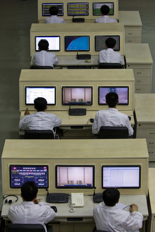 North Korean technicians man computer terminals at North Korea's space agency's General Launch Command Center on the outskirts of Pyongyang Wednesday, April 11, 2012. Engineers are pumping fuel into a rocket that is set to carry a satellite into space, officials at the North Korean space agency's central command center said Wednesday, showing reporters a live feed of the west coast launch pad. (AP Photo/David Guttenfelder)
