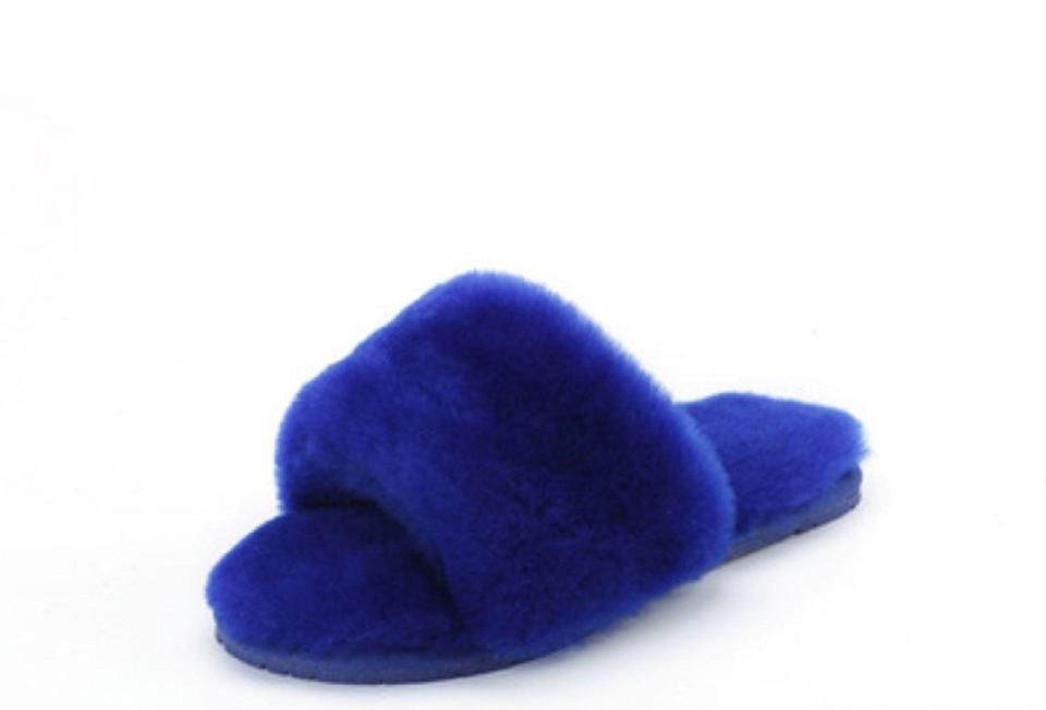 """<p><strong>Confetti</strong></p><p>confetti-boutique.com</p><p><strong>$55.00</strong></p><p><a href=""""https://www.confetti-boutique.com/collections/fur-slides-slippers/products/blue-lamb-fur-slippers"""" rel=""""nofollow noopener"""" target=""""_blank"""" data-ylk=""""slk:Shop Now"""" class=""""link rapid-noclick-resp"""">Shop Now</a></p><p>These bright-blue slides are cozy and cute enough to wear in and out of your house. </p>"""