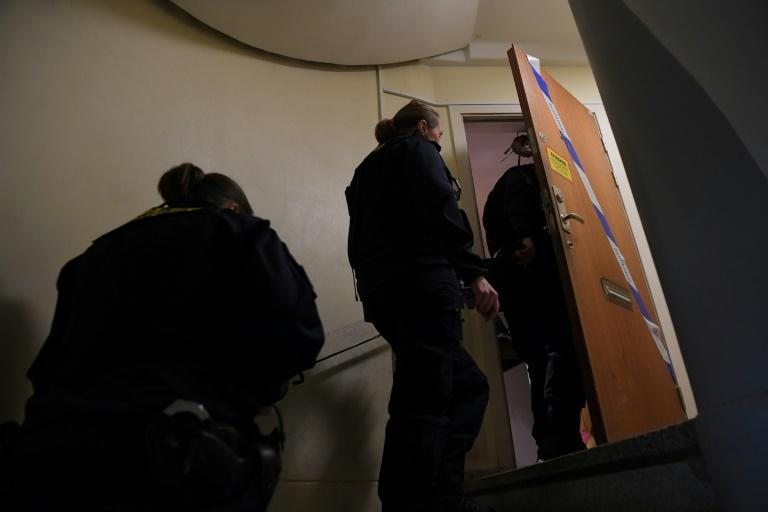 Police technicians enter the apartment in a Stockholm suburb where the mother is suspected of keeping her son for 28 years