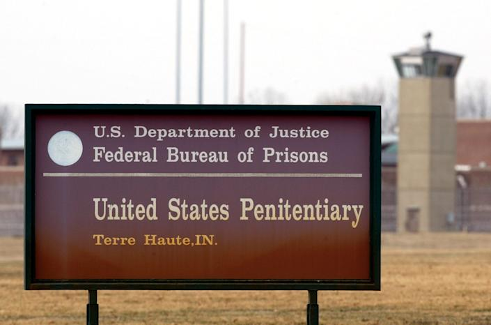 The guard tower flanks the sign at the entrance to the U.S. Penitentiary in Terre Haute, Indiana, site of the last federal execution. This is a March 17, 2003, file photo. The Justice Department says it will carry out executions of federal death row inmates in 2019 for the first time since 2003.