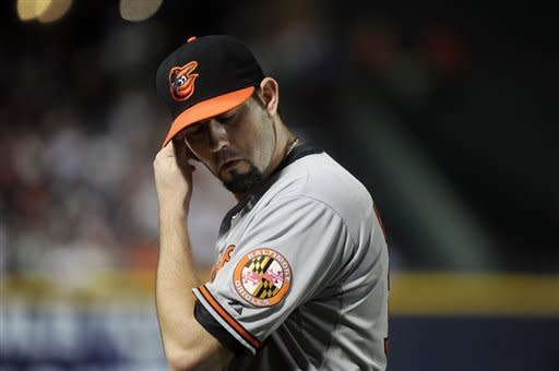 Baltimore Orioles pitcher Jason Hammel comes off the field in the seventh inning after having his potential perfect baseball game interrupted by walking Atlanta Braves' Dan Uggla on Saturday, June 16, 2012, in Atlanta. Hammel pitched a complete game and Baltimore won 5-0. (AP Photo/John Amis)