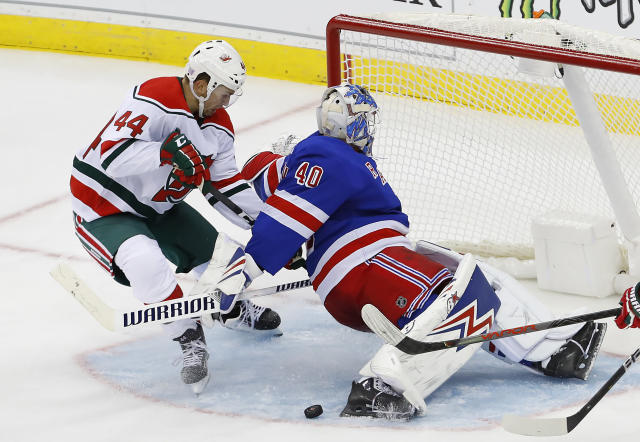 New York Rangers goaltender Alexandar Georgiev (40) makes save against New Jersey Devils left wing Miles Wood (44) during the third period of an NHL hockey game Saturday, Nov. 30, 2019, in Newark,N.J. (AP Photo/Noah K. Murray)
