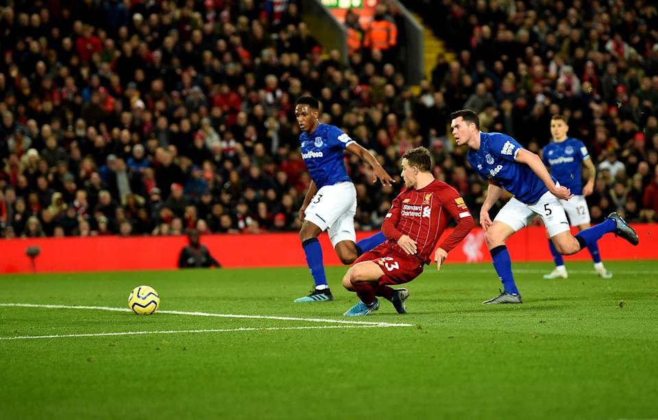 LIVERPOOL, ENGLAND - DECEMBER 04: (THE SUN OUT, THE SUN ON SUNDAY OUT) Xherdan Shaqiri  of Liverpool  scores the Second Goal  and celebrates during the Premier League match between Liverpool FC and Everton FC at Anfield on December 04, 2019 in Liverpool, United Kingdom. (Photo by Andrew Powell/Liverpool FC via Getty Images)