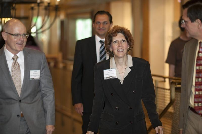 Mester, President and CEO of the Federal Reserve Bank of Cleveland, walks with McAndrews, vice president of the Federal Reserve Bank of New York, as they arrive for the opening reception of the Jackson Hole Economic Policy Symposium