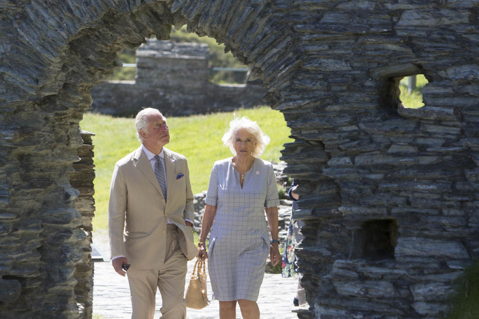 TINTAGEL, ENGLAND - JULY 20:  Prince Charles, Prince of Wales and Camilla, Duchess of Cornwall walk through the ruins of Tintagel Castle during their visit to Cornwall, south west England on July 20, 2020 in Tintagel, England. (Photo by Geoff Caddick - WPA Pool/Getty Images)