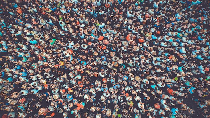 People crowd texture background. Bird eye view. Toned. (Photo: Dmytro Varavin via Getty Images)