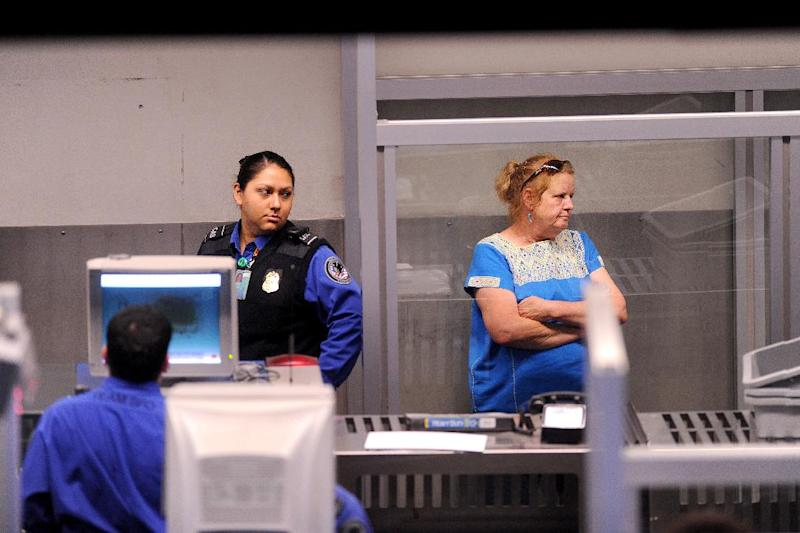"In this Monday, Aug. 1, 2011, photo, an unidentified traveler undergoes a secondary security screening at San Francisco International Airport in San Francisco. Airline executives said Tuesday, Oct. 16, 2012, at a global aviation conference that Airport security needs to undergo a radical overhaul or else passengers will become further disgruntled, lines will grow and terminals will be overwhelmed. ""We simply can't cope with the expected volume of passengers with the way things are today,"" said Tony Tyler, director general and CEO of the International Air Transport Association, the airlines' trade group. (AP Photo/Noah Berger)"