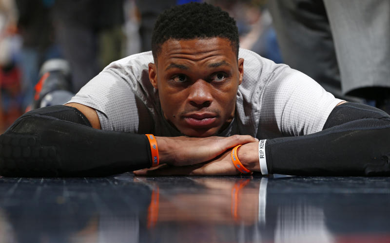 Oklahoma City Thunder guard Russell Westbrook stretches before a game against the Denver Nuggets Sunday, April 9, 2017, in Denver. (AP Photo/Jack Dempsey)