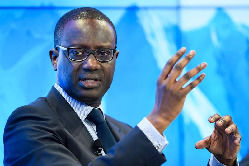 "Credit Suisse's Chief Executive Officer (CEO) Tidjane Thiam gestures during a pannel ""Size Matters: The Future of Big Business"" on January 17, 2017 in Davos on the first day of the World Economic Forum. The global elite begin a week of earnest debate and Alpine partying in the Swiss ski resort of Davos on January 17, 2017 in a week bookended by two presidential speeches of historic import. / AFP / FABRICE COFFRINI (Photo credit should read FABRICE COFFRINI/AFP via Getty Images)"