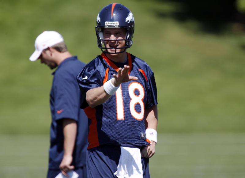 Denver Broncos quarterback Peyton Manning directs players during the team's minicamp at Broncos headquarters in Englewood, Colo., on Monday, May 21, 2012. (AP Photo/David Zalubowski)
