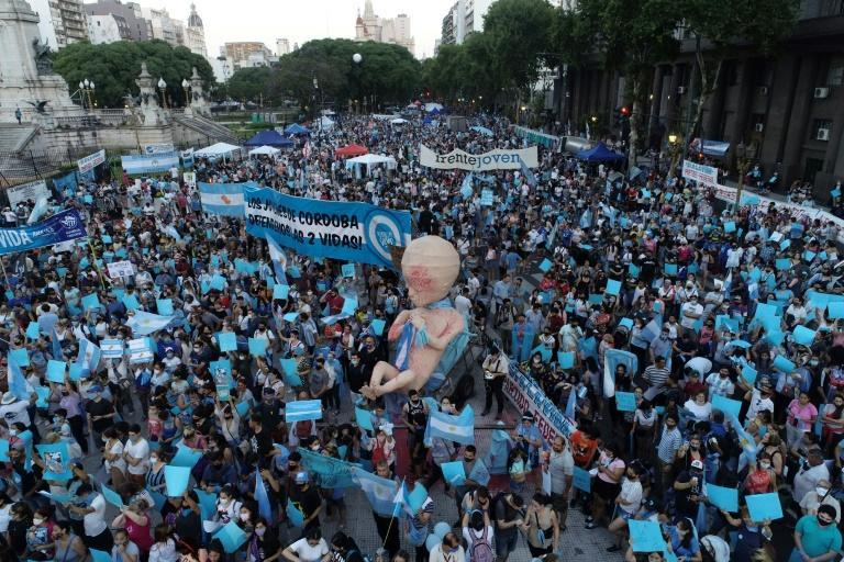 Anti-abortion activists gather outside the Argentine Congress as senators debate a landmark bill on whether to legalize abortion, in Buenos Aires, on December 29, 2020