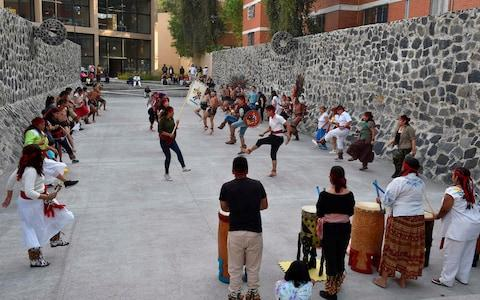 """Dancers and players perform ahead of a pre-Columbian ballgame called """"Ulama"""" - Credit: AFP"""