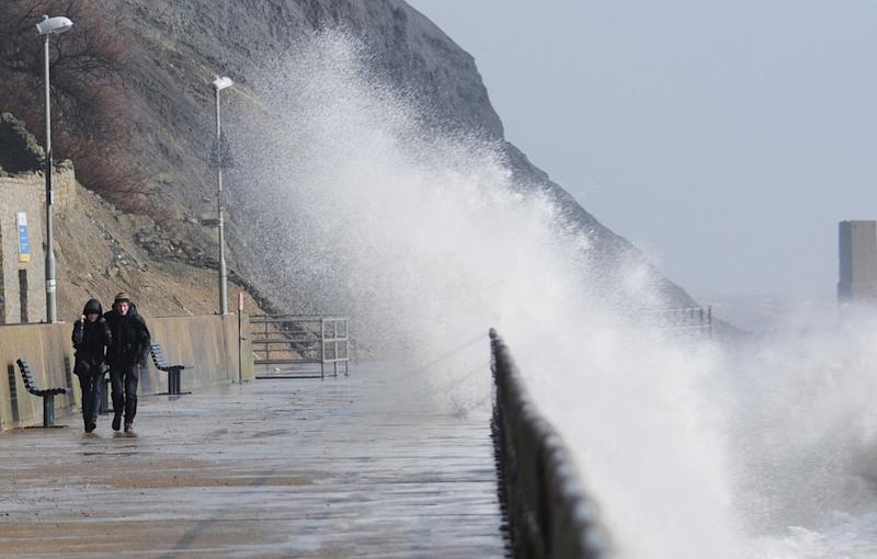 Waves during high tide at Sunny Sands Beach in Folkestone, as two people have died and tens of thousands of homes are without power as Britain's severe weather continues to bring flood misery to parts of the country.