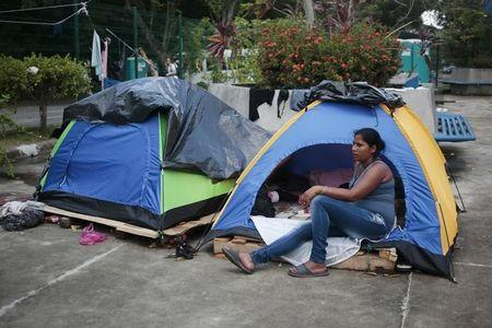 A Cuban migrant rests outside her tent at a temporary shelter in the border, between Costa Rica and Nicaragua, in Penas Blancas, Costa Rica