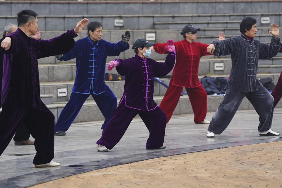 Residents practice tai chi at a park in Wuhan in central China's Hubei Province on Saturday, Jan. 23, 2021. A year after it was locked down to contain the spread of coronavirus, the central Chinese city of Wuhan has largely returned to normal, even as China continues to battle outbreaks elsewhere in the country. (AP Photo/Ng Han Guan)