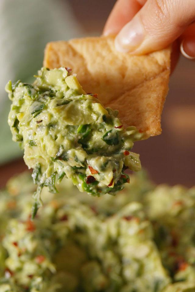 "<p>Adding avocado to spinach artichoke dip is seriously life changing.</p><p>Get the recipe from <a rel=""nofollow"" href=""http://www.delish.com/cooking/recipe-ideas/recipes/a53717/avocado-spinach-artichoke-dip-recipe/"">Delish</a>.</p><p><strong><em>SMOOTH IT OUT: Black & Decker 8-Cup Food Processor, $28; <a rel=""nofollow"" href=""http://buy.geni.us/Proxy.ashx?TSID=21947&GR_URL=https%3A%2F%2Fwww.amazon.com%2FBLACK-DECKER-FP1600B-8-Cup-Processor%2Fdp%2FB0038KPRG6%3Ftag%3Ddelish_auto-append-20%26ascsubtag%3Ddelish.article.53717"">amazon.com</a>.</em></strong></p>"