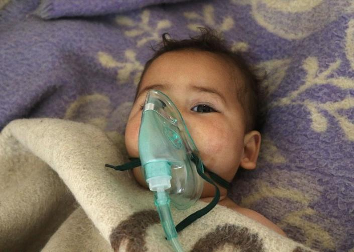 This photo taken on April 04, 2017 shows a Syrian child receiving treatment at a small hospital in the town of Maaret al-Noman following a suspected toxic gas attack in Khan Sheikhun, a nearby rebel-held town in Syria's northwestern Idlib province (AFP Photo/Mohamed al-Bakour)