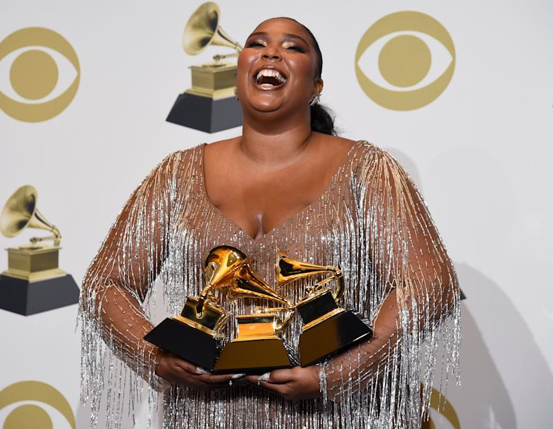 Lizzo poses poses with her Grammy awards on Sunday. (Photo: Chris Pizzello/Invision/AP)
