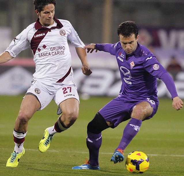 Fiorentina's Giuseppe Rossi, right, fights for the ball with Livorno's Marco Biagianti during a Serie A soccer match at the Artemio Franchi stadium in Florence, Italy Sunday Jan. 5, 2014. (AP Photo/Fabrizio Giovannozzi)