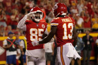 Kansas City Chiefs wide receiver Marcus Kemp (85) is congratulated by wide receiver Byron Pringle (13) after scoring during the first half of an NFL football game against the Minnesota Vikings Friday, Aug. 27, 2021, in Kansas City, Mo. (AP Photo/Charlie Riedel)