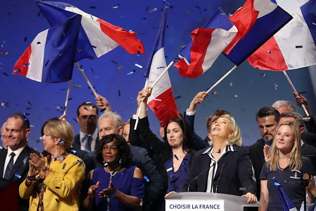 <p>French presidential election candidate for the far-right Front National (FN) party Marine Le Pen (2ndR) is applauded by supporters at the end of a campaign meeting, on April 27, 2017 in Nice. (Valery Hache/AFP/Getty Images) </p>