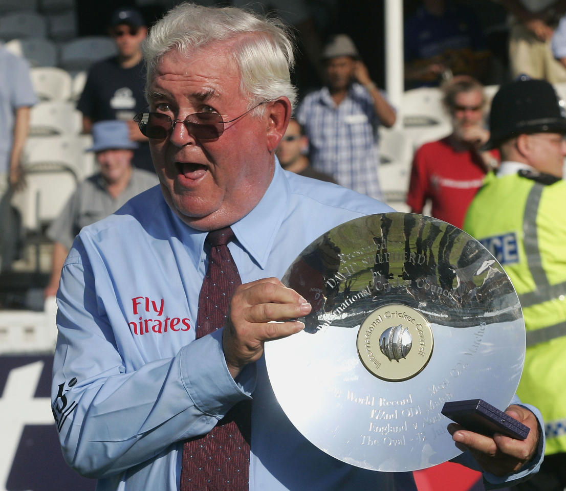 LONDON - JULY 12:  Umpire David Shepherd with the trophy presented to him after his last international match after the NatWest Challenge One Day International match between England and Australia played at The Oval on July 12, 2005 in London, United Kingdom  (Photo by Hamish Blair/Getty Images)