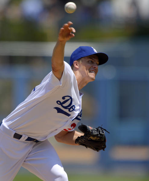 Los Angeles Dodgers starting pitcher Zack Greinke throws during the first inning of a baseball game against the Tampa Bay Rays, Saturday, Aug. 10, 2013, in Los Angeles. (AP Photo/Mark J. Terrill)