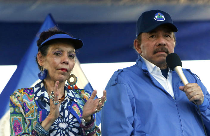 """FILE - In this Sept. 5, 2018 file photo, Nicaragua's President Daniel Ortega and his wife, Vice President Rosario Murillo, lead a rally in Managua, Nicaragua. As international health organizations warn of increasing infections in Nicaragua and independent Nicaraguan doctors call for a voluntary quarantine to slow the spread of the delta variant, the government has made clear that comments out of step with its line are unacceptable as Ortega seeks a fourth consecutive term. Murillo has accused doctors of """"health terrorism."""" (AP Photo/Alfredo Zuniga, File)"""