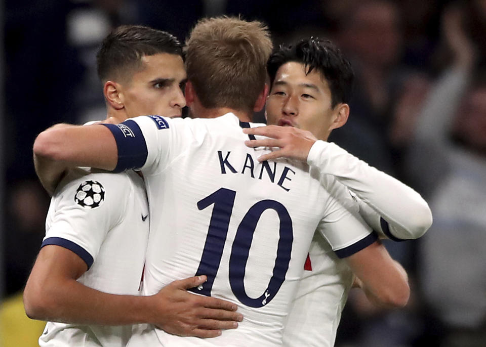 Tottenham Hotspur's Son Heung-min, right, celebrates scoring his side's second goal of the game with Harry Kane and Erik Lamela during the Champions League Group B match against Red Star at Tottenham Hotspur Stadium, London, Tuesday Oct. 22, 2019. (Nick Potts/PA via AP)