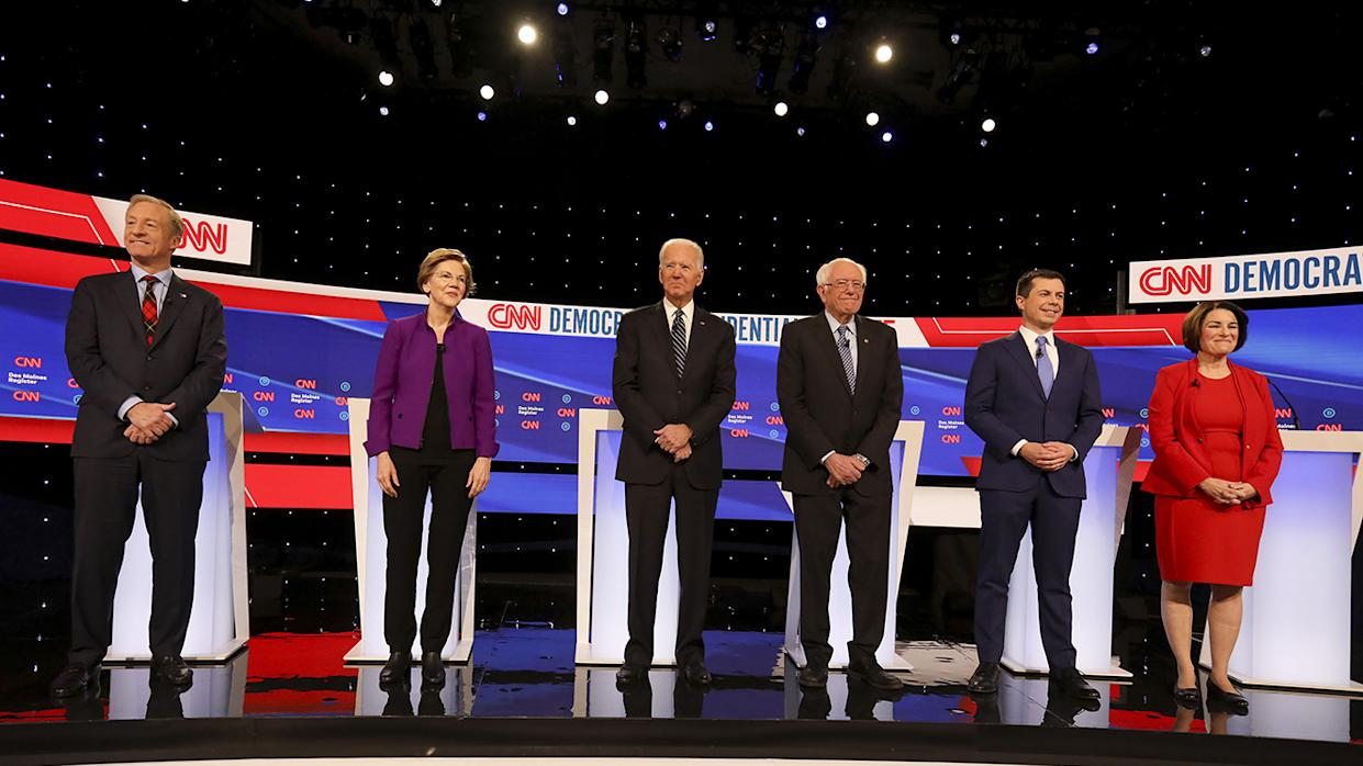 Democratic presidential candidates, stand on stage ahead of Tuesday's debate in Des Moines. (Daniel Acker/Bloomberg via Getty Images)