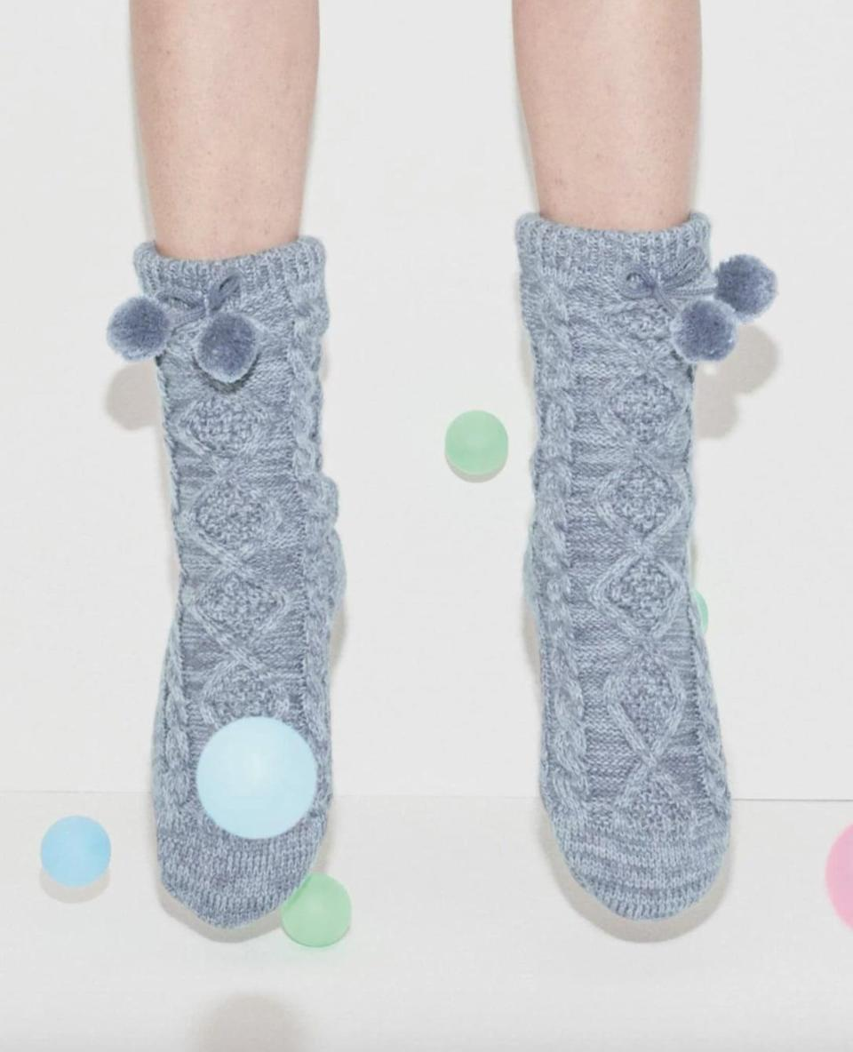 <p>You won't want to forget about stocking stuffers, and you can never wrong with a pair of cozy socks. The <span>UGG Pompom Fleece Lined Socks</span> ($50) are comfy and will surely make them happy.</p>