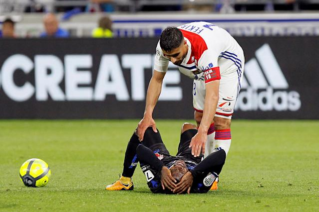 Soccer Football - Ligue 1 - Olympique Lyonnais vs OGC Nice - Groupama Stadium, Lyon, France - May 19, 2018 Lyon's Nabil Fekir with Nice's Jean Michael Seri REUTERS/Emmanuel Foudrot