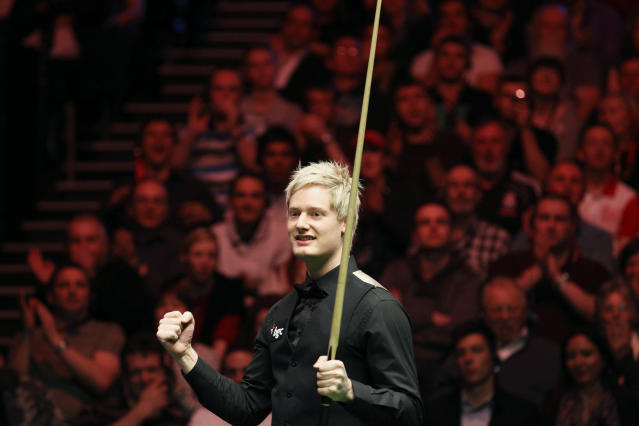 Australia's Neil Robertson punches the air after winning the BGC masters snooker tournament at Alexandra Palace in London, on January 22, 2012. Australia's 2010 world champion Neil Robertson claimed the Masters title with a 10-6 win over England's Shaun Murphy at Alexandra Palace. AFP PHOTO / JUSTIN TALLIS (Photo credit should read JUSTIN TALLIS/AFP/Getty Images)