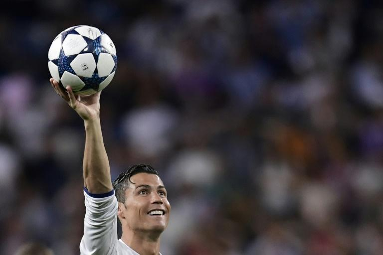 Real Madrid's forward Cristiano Ronaldo  and Real host Atletico Madrid in the Champions League semi-finals