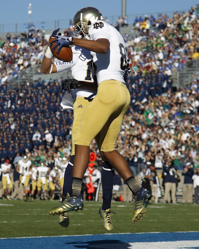 Notre Dame wide receiver Corey Robinson, front, celebrates his touchdown reception with teammate William Fuller against Air Force in the first quarter of an NCAA college football game in Air Force Academy, Colo., Saturday, Oct. 26, 2013. (AP Photo/David Zalubowski)